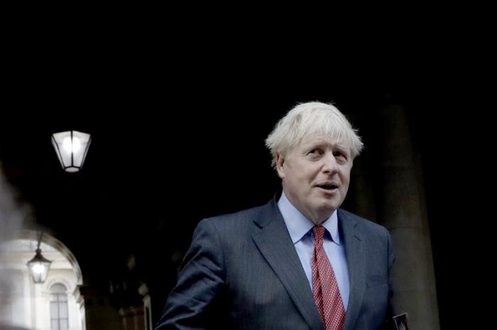 UK's Johnson Slams Brakes on Reopening as COVID Cases Surge