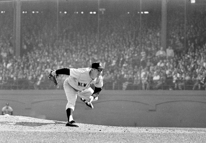 In this Oct. 12, 1960 file photo, New York Yankees pitcher Whitey Ford throws during the 6th game of the World Series against the Pittsburgh Pirates in Pittsburgh.