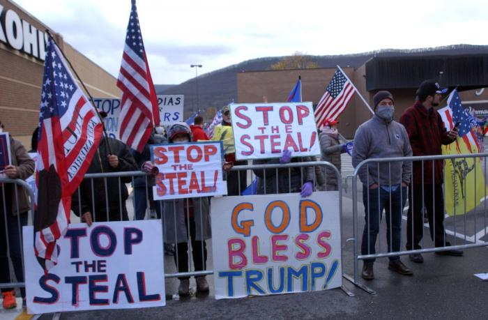 Approximately 100 Trump supporters some with flags and signs stood across West Third Street from the Federal Building in Williamsport, Pa., for hours Tuesday, Nov. 17, 2020, chanting such things as 'Four More Years,' 'Black Lives Matter,' 'We Want Trump' and 'Dead People Can't Vote.'
