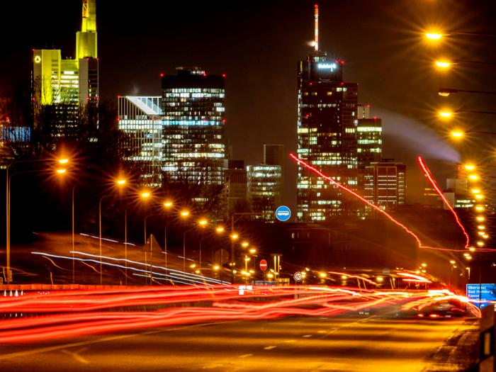 Long time exposure photo shows commuters driving towards Frankfurt, Germany, Thursday, Jan. 14, 2021. In background the buildings of the banking district