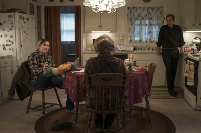 """From left to right: Kate Winslet, Jean Smart, and Neal Huff in a scene from """"Mare of Easttown."""""""